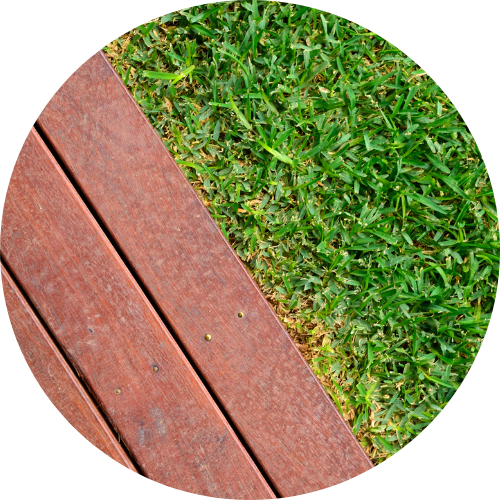 composite decking Brisbane - wood and grass