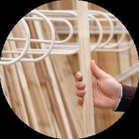 timber flooring - man picking timber